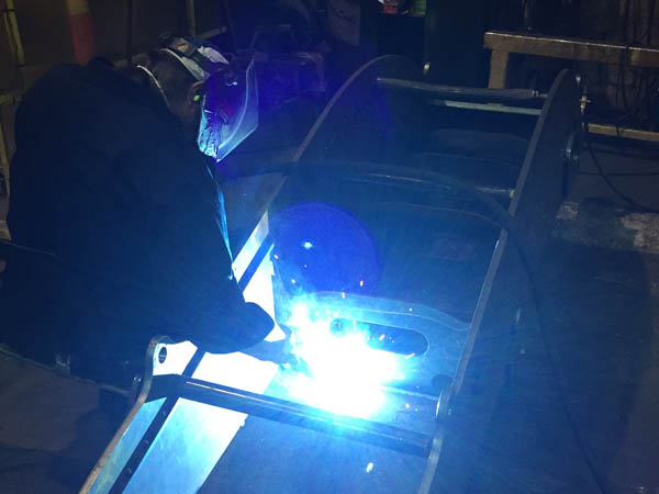 worker welding steel plates